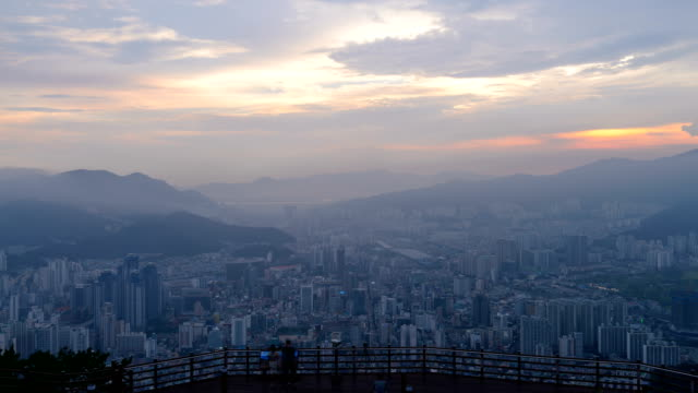 sunset to night view of tourists watching the cityscape and hwangnyeongsan mountain - sunset to night stock videos & royalty-free footage