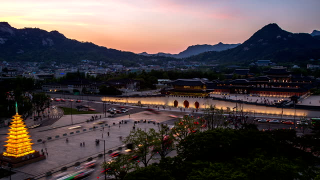 sunset to night view of traffic moving and gyeongbokgung ancient palace - sunset to night stock videos & royalty-free footage