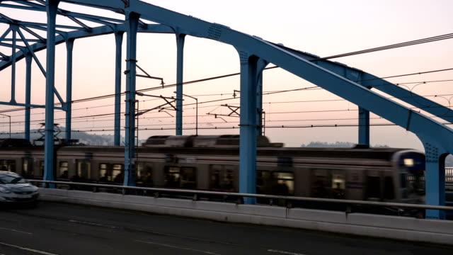 sunset to night view of traffic moving on dongjakdaegyo bridge - sunset to night stock videos & royalty-free footage