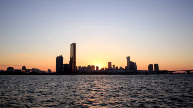 sunset to night view of yeouido financial district - sunset to night stock videos & royalty-free footage