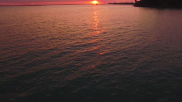 stockvideo's en b-roll-footage met sunset - horizon over water