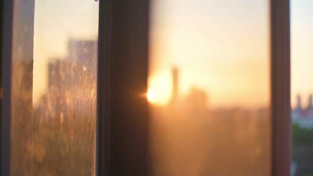 sunset view blur hour magic hour from domestic room window to cityscape - back lit stock videos & royalty-free footage