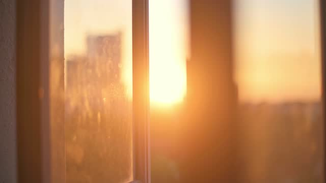 sunset view blur hour magic hour from domestic room window to cityscape - town stock videos & royalty-free footage