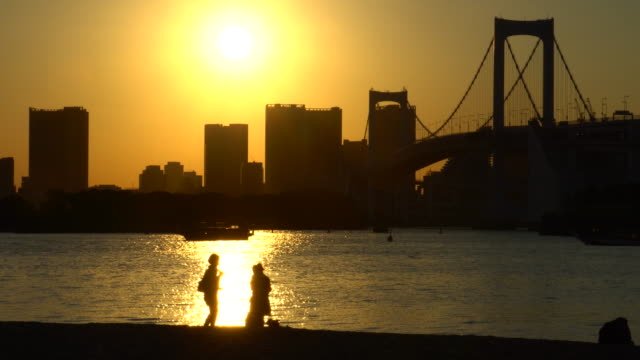 sunset view from odaiba / couple - waterfront stock videos & royalty-free footage