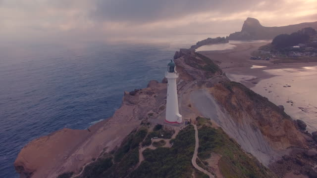 sunset view of castlepoint lighthouse. - south pacific ocean stock videos & royalty-free footage