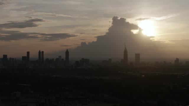 WS PAN AERIAL POV Sunset view of city skyline with Bank of America Plaza / Atlanta, Georgia, United States