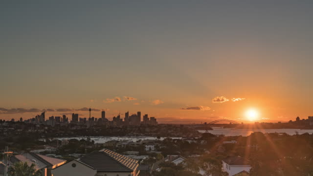 sunset view of cityscape of sydney in distant - sunset stock videos & royalty-free footage