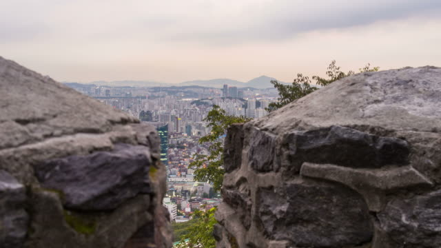 Sunset view of downtown district in the Myeong Dong area from the Seoul fortified wall