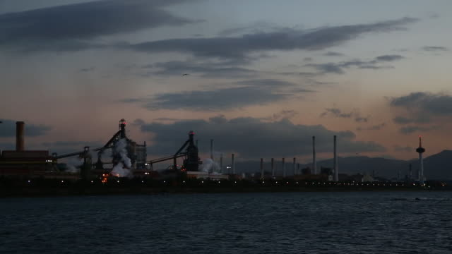 sunset view of factory of pohang iron & steel corporation - steel stock videos & royalty-free footage