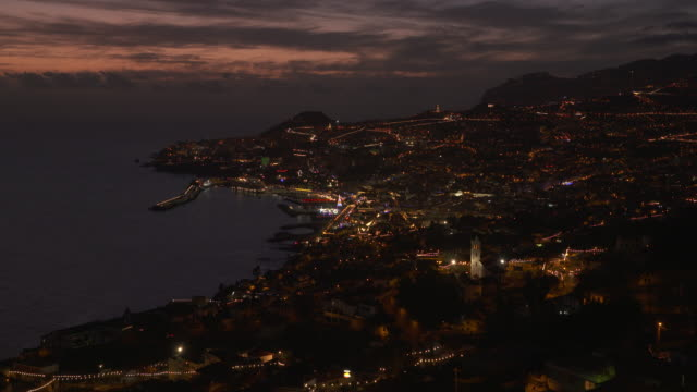 sunset view of funchal with harbor, elevated view from the sao goncalo district. funchal, madeira, portugal. - waterfront stock videos and b-roll footage
