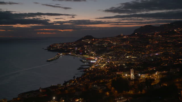 Sunset view of Funchal with harbor, elevated view from the Sao Goncalo district. Funchal, Madeira, Portugal.