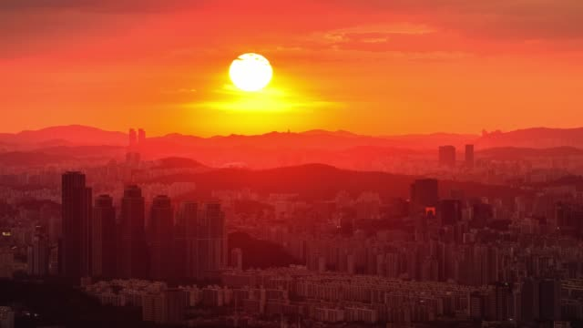 sunset view of gangnam-gu cityscape in seoul, south korea - moving down stock videos & royalty-free footage