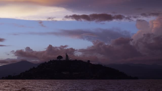 sunset view of janitzio island in michoacan state, mexico - michoacán video stock e b–roll