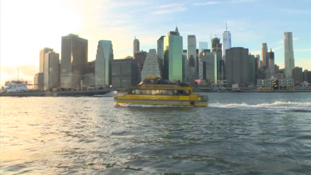 sunset view of lower manhattan skyline from brooklyn. brooklyn bridge. - brooklyn bridge stock videos & royalty-free footage