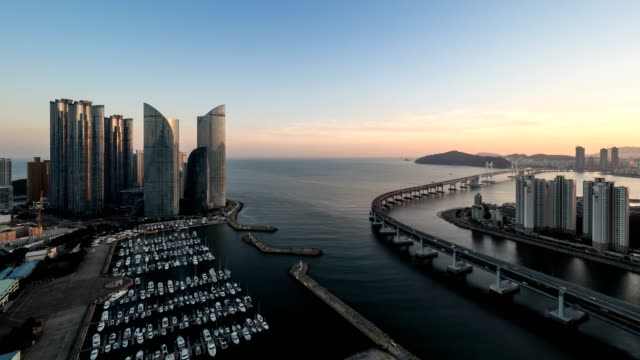 sunset view of marine city (expensive and prestigious residential area in busan) and suyeonggyo road in millak water park - busan stock videos & royalty-free footage