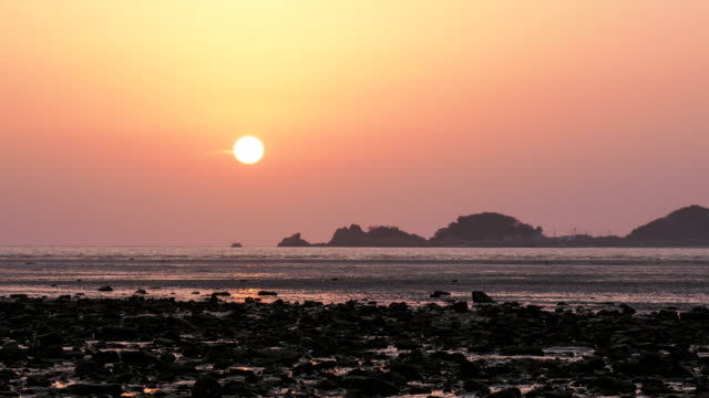 sunset view of mud flat at yongyu beach in yeongjong-do island - mud flat stock videos and b-roll footage
