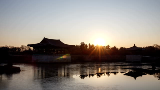 sunset view of pavilion and reflection of water surface at anapji pond(korea historic place 18) - north gyeongsang province stock videos & royalty-free footage