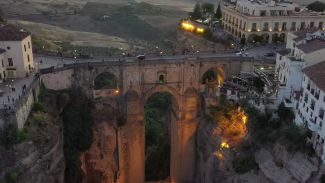 sunset view of puente nuevo and nearby area / ronda, spain - puente video stock e b–roll