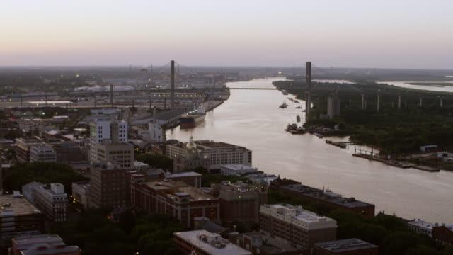 ws tu aerial pov sunset view of residential district with suspension bridge over river / savannah, georgia, united states - savannah georgia stock videos & royalty-free footage