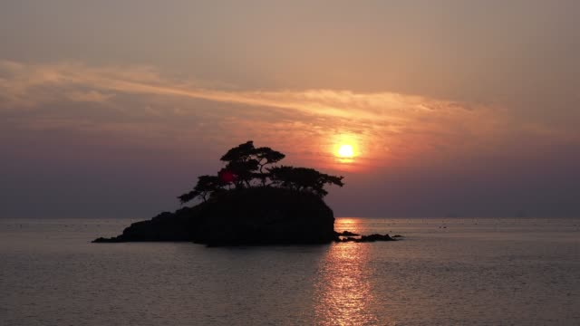 sunset view of solseom island(it is a famous palace for sunset) in buan-gun, jeollanam-do province - cay insel stock-videos und b-roll-filmmaterial