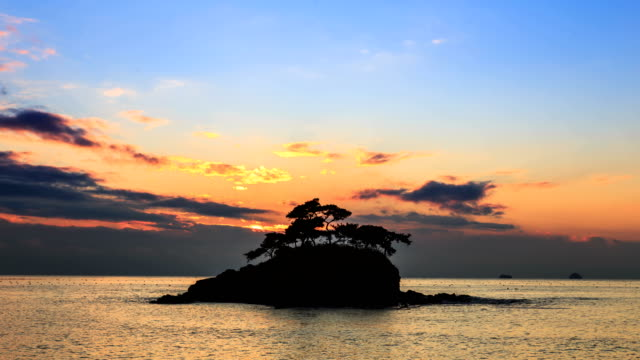 Sunset view of Solseom Island (Famous photo attractions in Korea) on the sea in Byeonsanbando National Park, Buangun