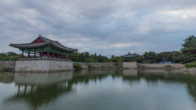sunset view of the gyeongju donggung palace and wolji pond(it was the banquet site for the important national event in the period of unified silla) in gyeongju-si - gyeongju stock videos & royalty-free footage
