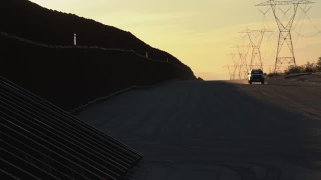 a sunset view of the international border wall, an agent patrolling,california, united states side - international border stock videos & royalty-free footage