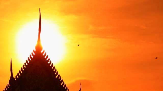 sunset view of the silhouette of a temple, thailand - thailand stock videos & royalty-free footage