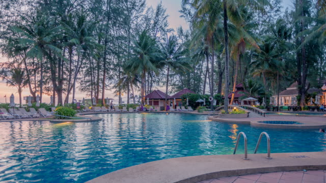 sunset view of the swimming pool in phuket, thailand - phuket stock videos & royalty-free footage