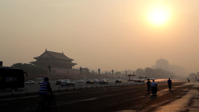 sunset view of tiananmen gate of heavenly peace (famous tourist destination) and traffic moving - tiananmen gate of heavenly peace stock videos & royalty-free footage