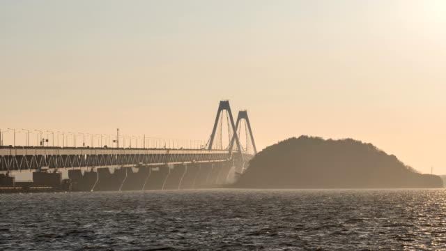 Sunset view of traffic moving on Yeongjongdaegyo Bridge and Yeongjong-do Island in fine dust