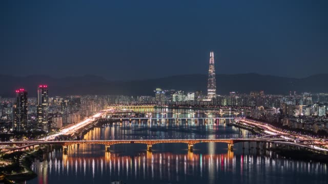 sunset view of traffics on the bridge over the han river and lotte world tower(the tallest building in korea) in seoul - part of vehicle stock videos & royalty-free footage