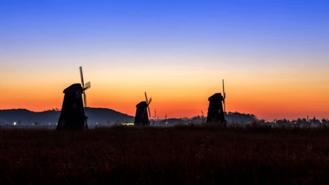 Sunset view of windmill on the reeds in Sorae Eco Park, in Incheon