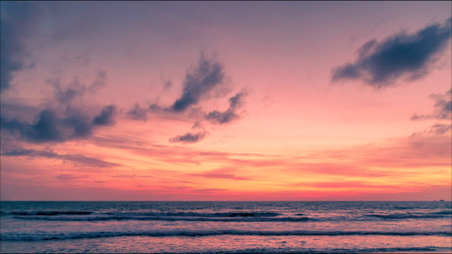 sunset view over the beach in phuket, thailand - red cloud sky stock videos & royalty-free footage