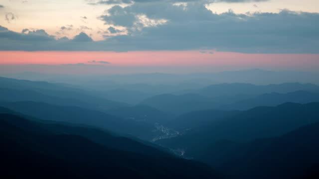 sunset view to night scenery view of hambaeksan mountain range - sunset to night stock videos & royalty-free footage