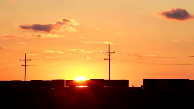 sunset west bound train hd - telegraph pole stock videos and b-roll footage