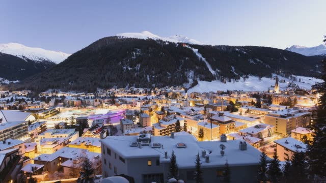 Sunset winter timelapse in winter the city of Davos, winter ski sports resort and home of the WORLD ECONOMIC FORUM every january, DAVOS, SWITZERLAND.