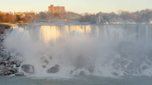 sunset winter view of niagara falls from canada looking to usa - niagara falls stock videos & royalty-free footage