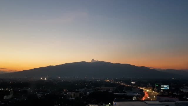 sunset with chiang mai city view and doi suthep mountain and road junction - penthouse stock videos & royalty-free footage