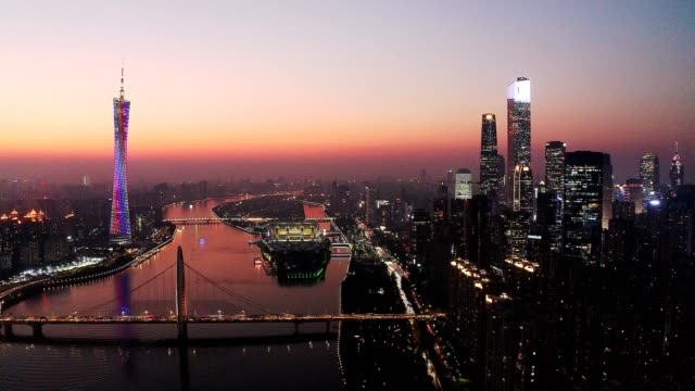 sunset with cityscape in guangzhou china - guangzhou stock videos & royalty-free footage