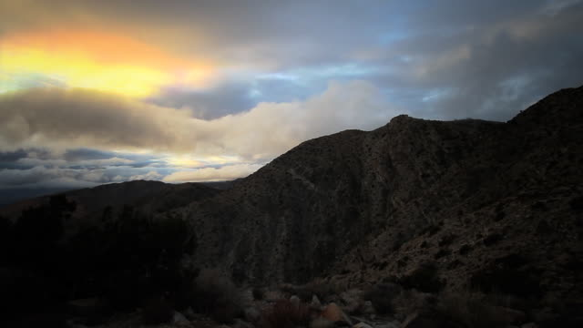 sunset with fog at joshua tree - roll over stock videos and b-roll footage