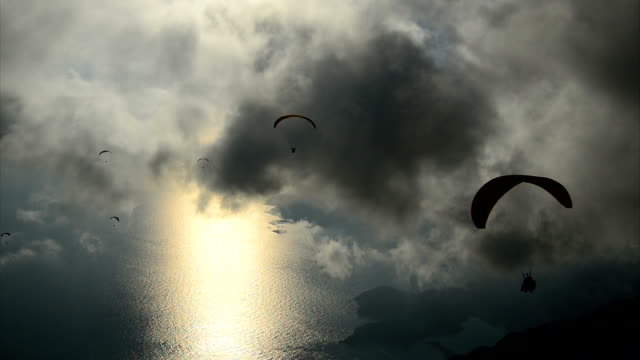 sunset with paragliding - fethiye stock videos and b-roll footage
