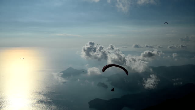 sunset with paragliding - oludeniz stock videos and b-roll footage