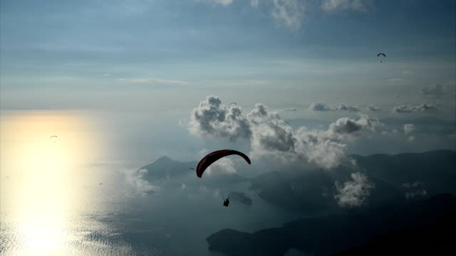 sunset with paragliding - paragliding stock videos & royalty-free footage