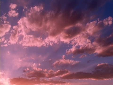 Sunset with purple sky and rolling clouds