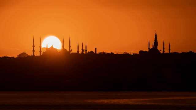 sunset with sun behind silhouette in istanbul,turkey - suleymaniye mosque stock videos and b-roll footage
