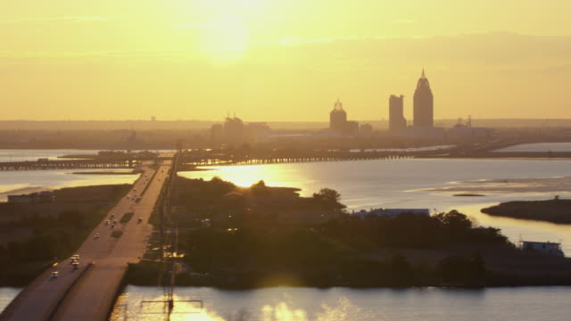 stockvideo's en b-roll-footage met sunset with view of mobile, alabama skyline and surrounding bay areas. - alabama