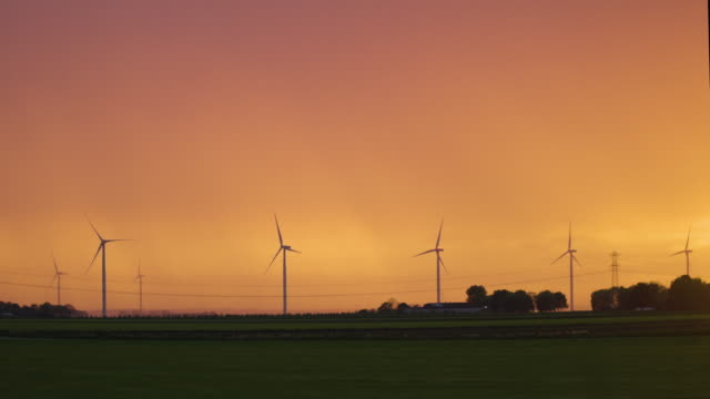 sunset with windmills in landscape nice colors