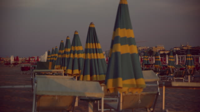 sunshades and beach loungers - beach umbrella stock videos and b-roll footage