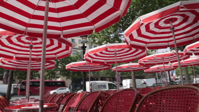 sunshades on avenue des champs elysees, paris, france, europe - parasol stock videos & royalty-free footage